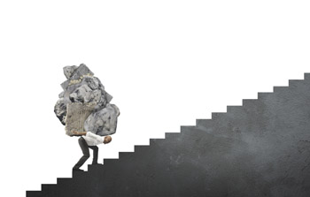 Man struggling up the stairs with a heavy load. Financial planning should help this heavy load by giving you more income at retirement