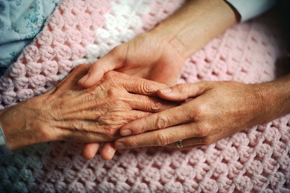 holding hands with elderly person, important to plan your estate and future for your retirement and family security